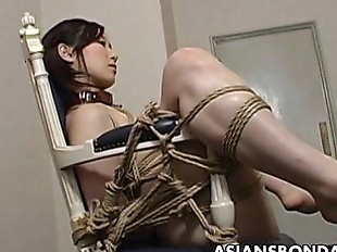 Extreme bondage and dildo fuck for an Asian babe..