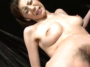 Slutty Natsumi lies down spreads her legs and is..