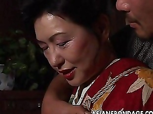 Asian mature bitch has a rope session to endure..