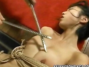 Two Asian bitches are tied up poked and proded -..